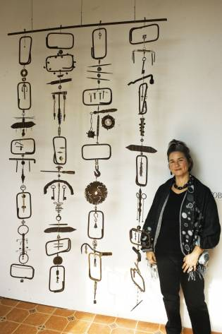 photo of Elayna Toby Singer and ReTooled kinetic sculpture